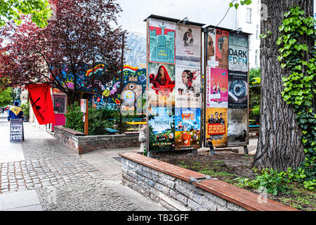 ACUD cultural Centre notice board and colourful wall of Max Fish beer garden in Veteranenstrasse Mitte,Berlin. - Stock Image