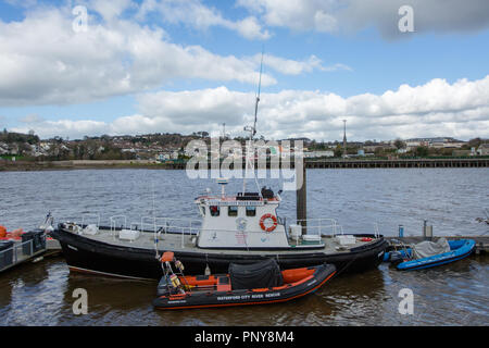 Waterford city river rescue boat and raft anchored at the River Suir marina in Waterford City - Stock Image