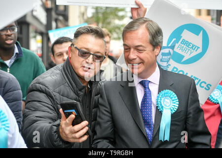 Brexit Party leader Nigel Farage has a selfie taken during the campaign trail in Exeter, ahead of this week's European elections. - Stock Image