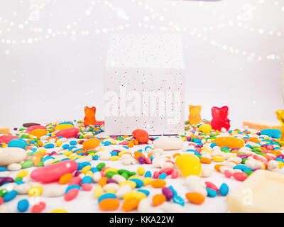 Christmas Decoration with Party Gift Box with lots of candies and jellies and golden bokeh for holidays best background - Stock Image