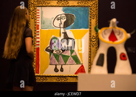 London, UK. 15 June 2017. Painting Femme accroupie by Pablo Picasso, 1954, est. GBP 6.5-8.5m and the sculpture Projet - Stock Image