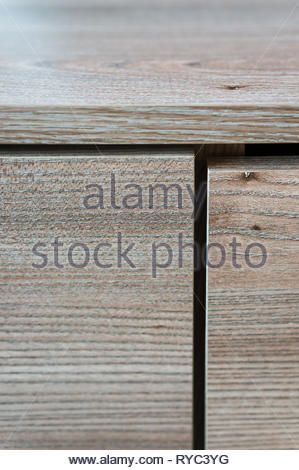 Close up of a wooden furniture drawer. - Stock Image