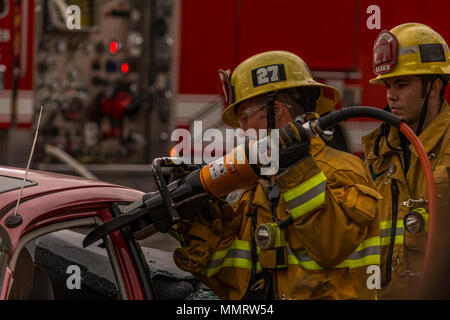 Los Angeles, California, USA 12 May 2018 A Los Angeles City Firefighter using a rescue tool. Credit: Chester Brown/Alamy Live News - Stock Image