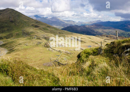 View from Moel Ddu mountainside across Cwm Oerddwr to distant Snowdon horseshoe mountains in Snowdonia National Park. Gwynedd, Wales, UK - Stock Image