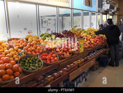 Fruit and vegetable bins in a store - Stock Image