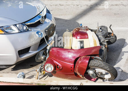 Miami Beach Florida Ocean Drive car scooter parking knocked down fall damage accident - Stock Image