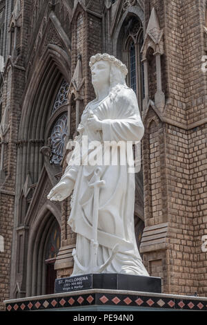 Statue of St. Philomena, in front of cathedral in Mysore - Stock Image