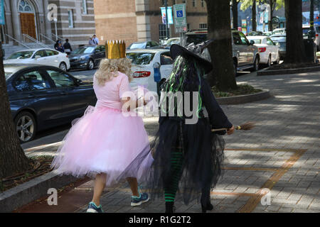 CHARLOTTE, NC, USA-10/31/18: Two women dressed for Halloween as good and evil witches. - Stock Image