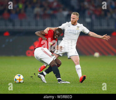 Optus Stadium, Burswood, Perth, W Australia. 17th July 2019. Manchester United versus Leeds United; pre-season tour; Paul Pogba of Manchester United is pulled off the ball by Adam Foresaw of Leeds United Credit: Action Plus Sports Images/Alamy Live News - Stock Image
