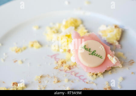 Letfovers of Torta Rosa (Pink Cake) at Bar Luce, Wes Anderson-inspired bar and cafe in the Fondazione Prada district of Milan, Italy - Stock Image