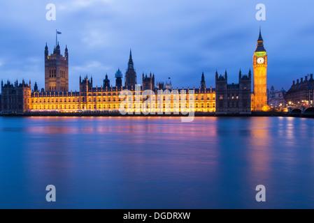 Illuminated Houses of Parliament at night London England - Stock Image
