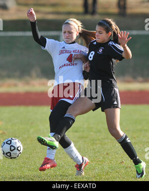 Sacred Heart Academy's Meghan Glynn and E.O. Smiths' Taylor Bilyak battle for possession during the first - Stock Image