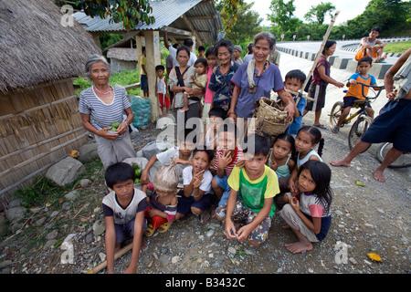 Mangyans wait at a bus stop near Mansalay, Oriental Mindoro, Philippines. - Stock Image