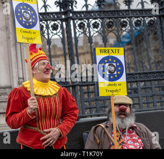 London, UK., UK. 27th Mar 2019. Brexit protesters clowing around dressed as clowns Credit: Ian Davidson/Alamy Live News - Stock Image