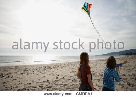 Children flying a kite - Stock Image