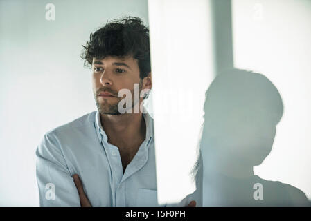 Serious business people looking away - Stock Image