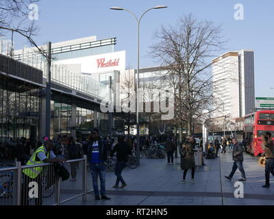 People milling around the bus station at Westfield, Shepherds Bush. - Stock Image