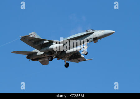 Modern military aviation. Royal Canadian Air Force CF-18 (CF-188) Hornet jet fighter aircraft in flight carrying - Stock Image