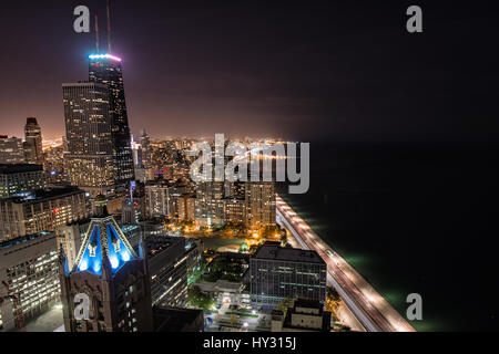 Aerial View Of City Lit Up At Night - Stock Image