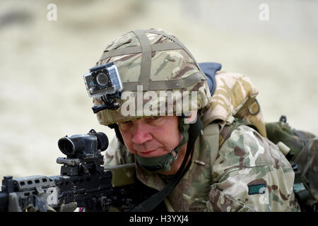 Soldier wearing a GoPro style action camera - Stock Image