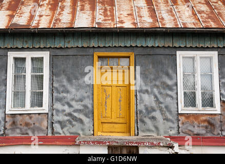 Dilapidated home in Janowiec village at Lubelska Street, old weathered house closeup, private property building - Stock Image