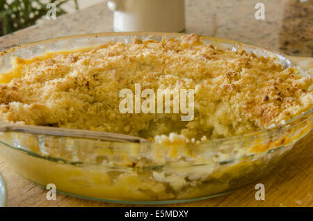 Veronica's Apple Crumble dish fresh from the oven with serving removed - Stock Image