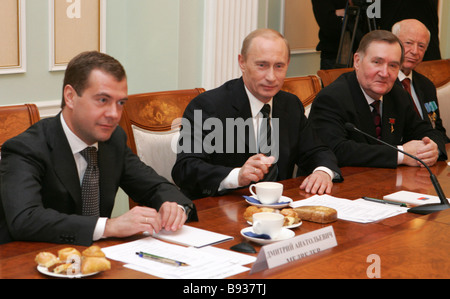 From left to right First Deputy Prime Minister Dmitry Medvedev and President Vladimir Putin meeting with veteran - Stock Image