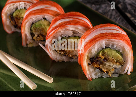 sushi closeup detail on green plate - Stock Image