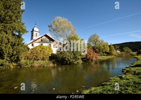 France, Doubs, Mouthe, the Doubs river shortly after its source, Assumption church dated 18th century - Stock Image