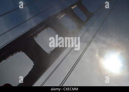 Sun breaking through the mist over the Golden Gate Bridge, San Franciso - Stock Image