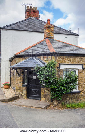 Ty Basket, a former Grade II listed Turnpike toll house at Usk, Monmouthshire, Wales, UK. - Stock Image