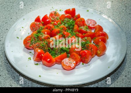 Cooking tomatoe - Stock Image