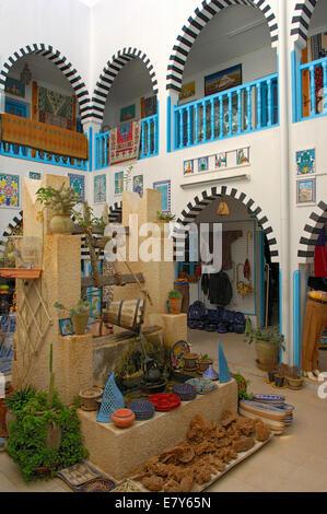 A souvenir mini-market in Houmt Souk whose name translates to 'marketplace' - Stock Image