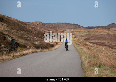 cycling from Poolewe to Cove along the shore of Loch Ewe, west coast of Scotland. - Stock Image
