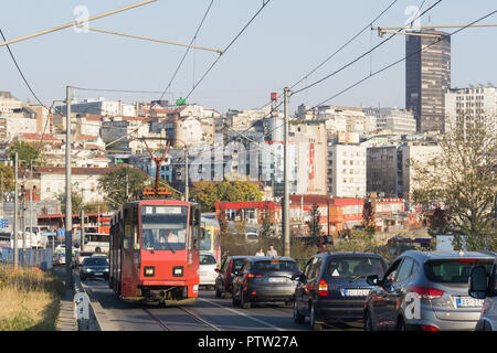 Belgrade cityscape - view of the Old Town (Stari Grad) and an old red tram. - Stock Image