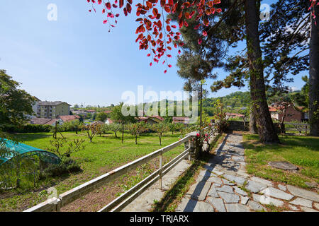 Garden and villa in a sunny summer day, Italy - Stock Image