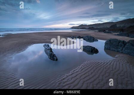 Twilight over Combesgate Beach on the North Devon coast, England. Winter (March) 2018. - Stock Image