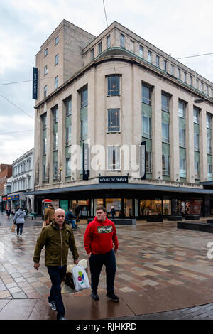 Binns, House of Fraser Department store exterior in Middlesbrough Cleveland North Yorkshire England UK with two men carrying shopping - Stock Image