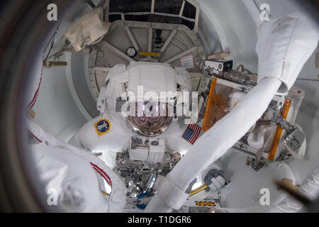 NASA astronaut Nick Hague inside the Quest Airlock before exiting the International Space Station for a spacewalk to upgrade the orbiting laboratory power system March 22, 2019 in Earth Orbit. - Stock Image