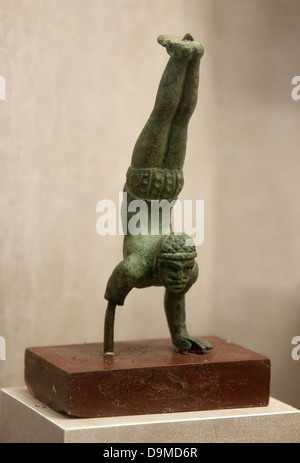 Small bronze Roman statue of a actrobat gymnast doing a hand stand in Rolin Museum Autun France - Stock Image