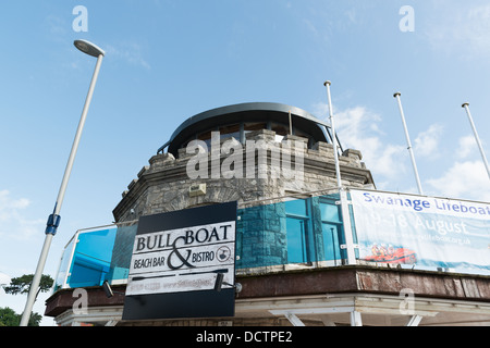 view of the Bull and Boat signage a bar and bistro from the beach at Swanage, Dorset - Stock Image