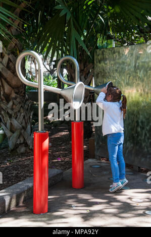 Child talking on a playground 'speaker phone' at South Bank, Brisbane, Queensland, Australia - Stock Image