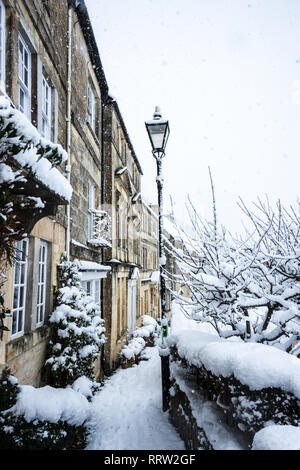 Picturesque christmas card scene of weavers cottages in the snow - Stock Image