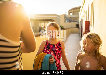 Girls near hotel - Stock Image