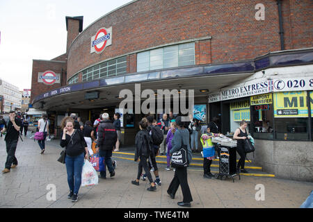 Wood Green tube Station exterior at afternoon rush hour - Stock Image