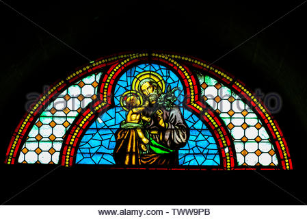 Stained glass window, Church of La Encarnacion,  in the hill top town of Montefrio, Granada Province, Andalusia, Spain. - Stock Image