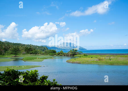 The Nanga Ba estuary with Mount Iya and the Ende peninsula in the background, Ende Regency, Flores Island, Indonesia. - Stock Image