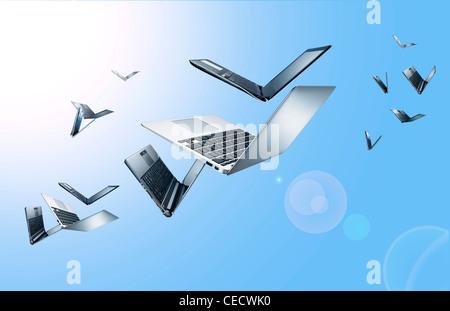 Flying laptops - Stock Image