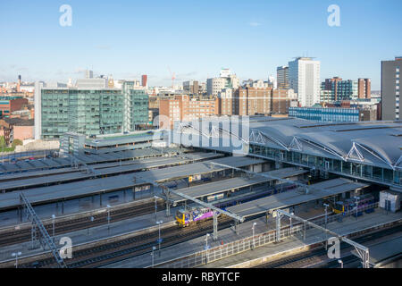 Leeds railway station and platforms viewed from above and city skyline, Leeds, West Yorkshire, UK - Stock Image