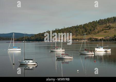 Boats anchored in the Huon River, southern Tasmania, Australia - Stock Image